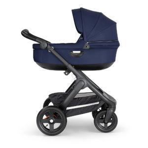 STOKKE ® Kinderwagen Trailz™ Black/Black mit Geländerädern und Babyschale Deep Blue - blau